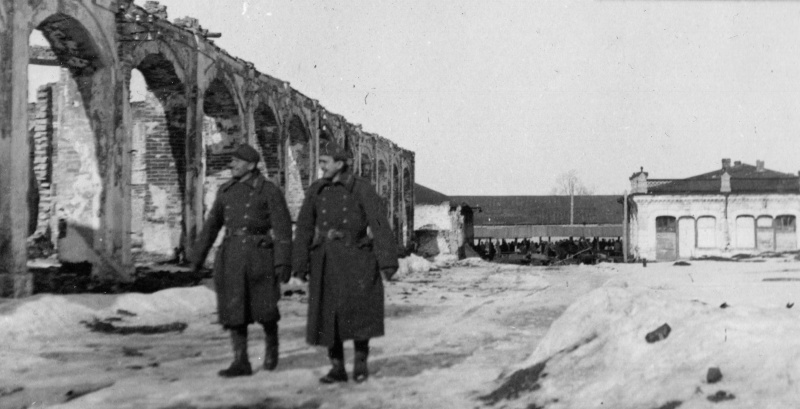 Hungarian soldiers passing ruins of the markets in the center of Priluki, 1941-1943
