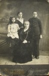 Yankel-Shmul Karasik (on the right) with mother Dvosya, two sisters. Mother died in evacuation in   Chelyabinsk during WWII.Older syster was killed during Civil War pogrom and younger was murdered during the Holocaust.