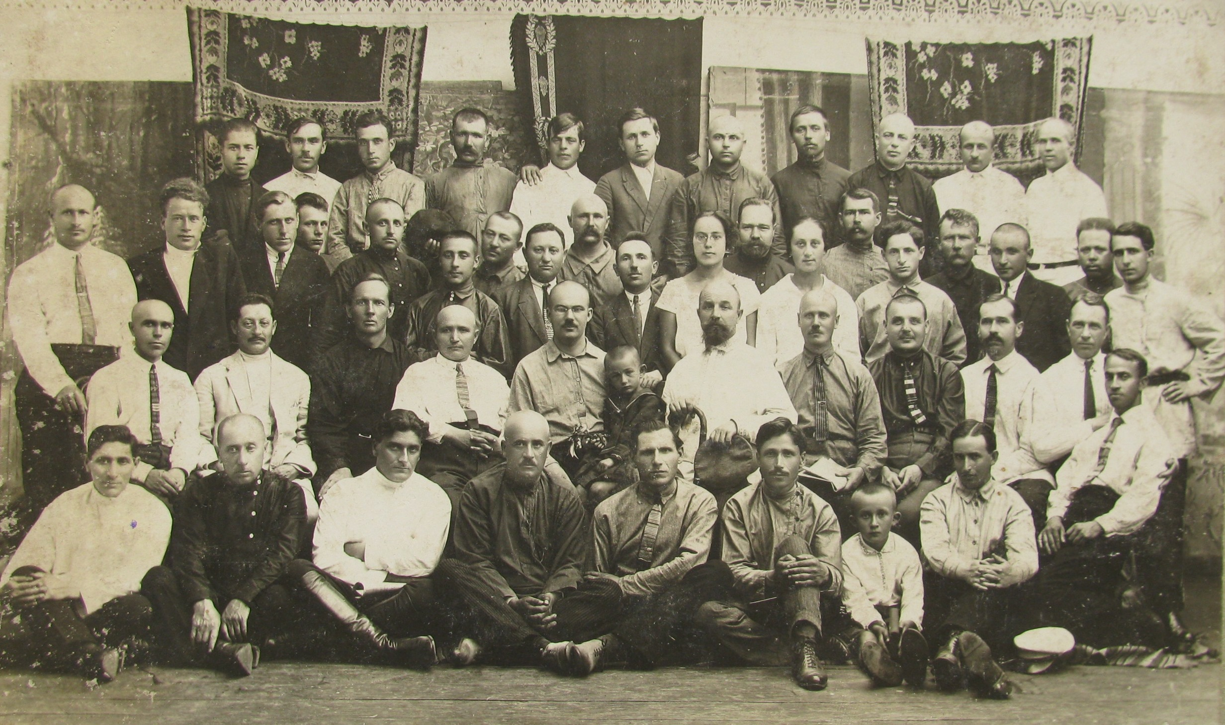 "Members of ""Souztabaksirye"". this organisation supplied tobacco to tobacco factories. Yankel-Shmul Meerovich Karasik (1885-1970) is sitting in the first row in the left corner. Priluki, 1930's"