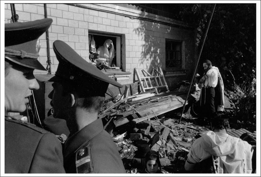 Demolishing of PostWWII non-Jewish house on Rabbi's Nahman grave, 1997. Photo by Jason Ashkenasi