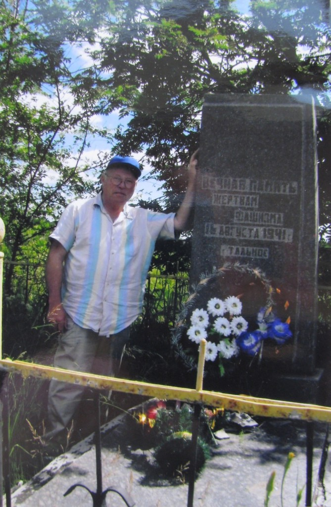 Holocaust survivour A. Mogilever near monument where was killed 9 members of his family, August 2010