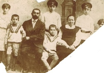 The man in the photo is Fishel. With him are his wife Malka, and their children.