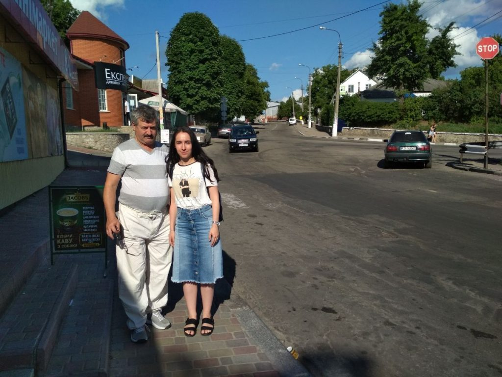 Roman Tivin in the historical center of Boguslav with tourist from Kiev