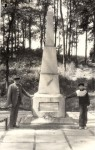 Dimitry Zilbermann and his grandson beside a monument, May 1988 . Photo by Yad Vashem.