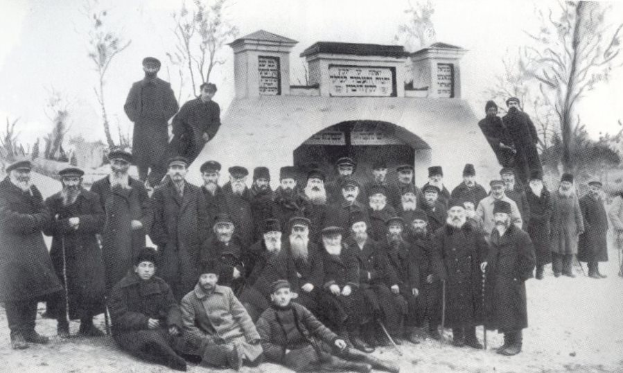 The Jewish community of Shepetovka poses in front of the new cemetery gare funded by the Shepetovka landsmanshaftn society in New York, 1928