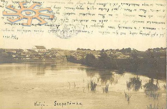 View of Shepetovka on postcard, 1902. Synagogue is a tall white building.