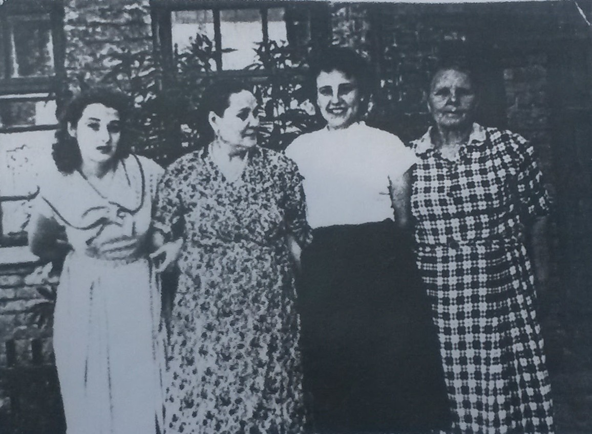 Local Jewish woman Fira (on left) who was saved during pogrom by S.L. Deputat in 1919. Photo was made during her visit in Byshov after WWII