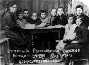 The 3d grade of Korsun Jewish school: teacher Sofiya Moiseevna Romanovskaya and pupils (from left to right) Zina Slozova, Boris Dubrovskiy, Misha Musikant, Mihail Medvinskiy, Manya Rudovskaya, Esha Soroka, Leyah Magitskaya, 1930's