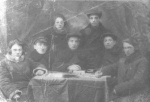 "Komsomol branch in korsun's ""The tanner union"" (left to right): First row - 1) Rose Markovna Tartakovsky 2) Moses Krugliy, 3) the secretary of the Komsomol committee Yacob Illich Ostrovsky, 4) Kuzma Kurinniy, 5) Oktyabrina Avramivna Petrushanskaya; Second row - 1) Sima Tsyrulnikova, 2) Leo Moiseevich Dranov, 1929"