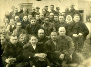 "Jewish tailors among workers of co-operative ""Progress"" (from left to right): First row - 2) Motl-procurer 3) Leib Ovseevich Kashvin; Third row - 2) Huna Ovseevich Kashvin 4) Head of co-operative Haim Petrushanskiy 6) Book-keeper Moses Peremishlyansky; 4th row - 4) Dranovsky, 10) Hirsch Shor, 1937"
