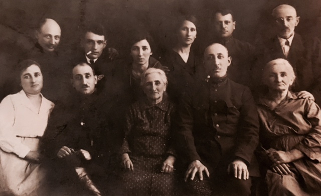 Muzykant family with Chava Muzykant-Noskin seated in center. Tarashcha,1925. Photo provided by Joel Levit