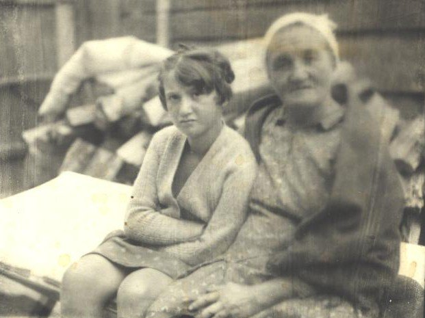 Bella Rochelle Hrisman-Gartsman with grandaughter(?), Ivankov 1930's. Photo provided by Joshua Yurman. She was married to Eliyahu Gartsman. The Nazis killed her when she was 97 years old in Ivankov, Ukraine. When she was young girl, Bella Rochelle was arranged to marry a man in a neighboring shtetl (village). Though she did not know the man, she understood that her parents had made a good match. After marrying Eliyahu Gartsman, the two moved to Ivankov, Ukraine, where they started a large family with 11 children and countless grandchildren. Countless descendants of Bella live today across the globe.