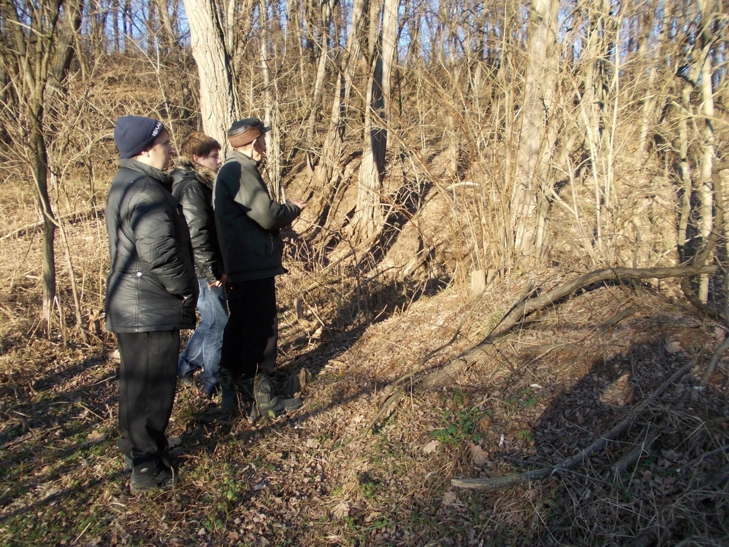 Jeremy Borowits and local historian near unmarked Holocaust mass grave in Medvin