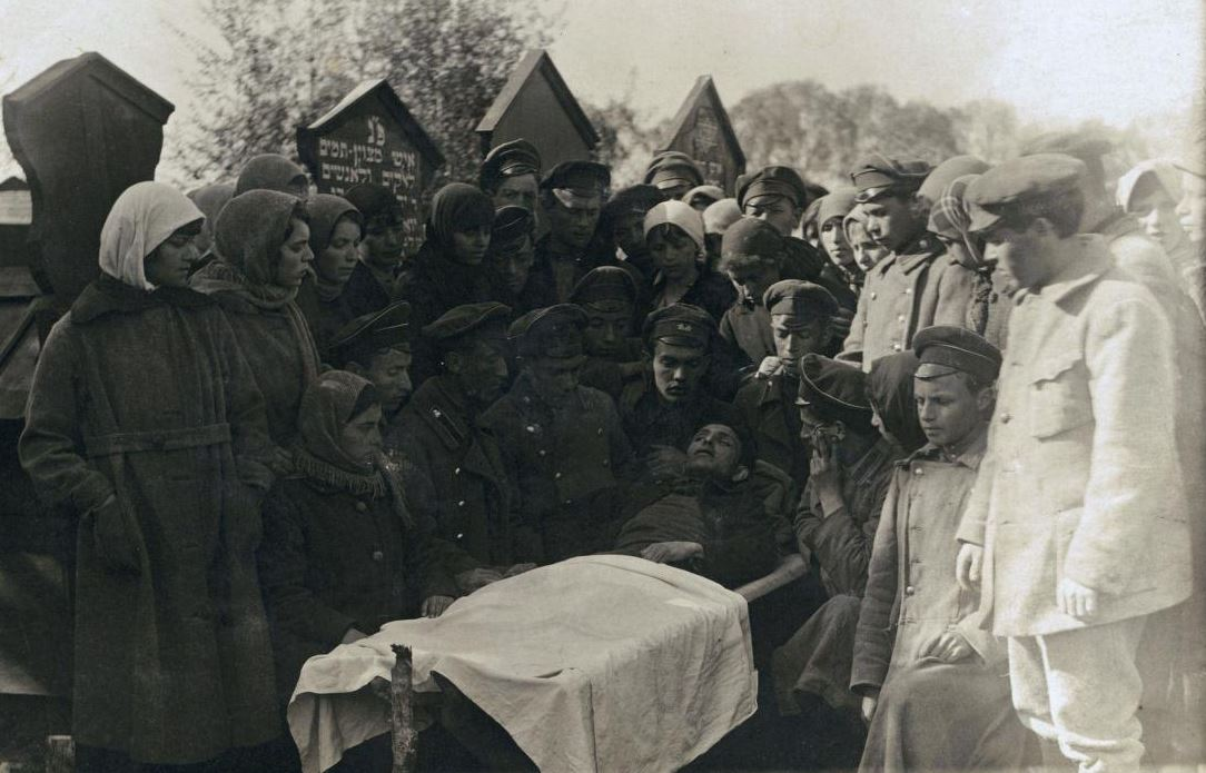Mourners at the cemetery with the body of a young man who was killed in a pogrom, Ivankov 1919-1921